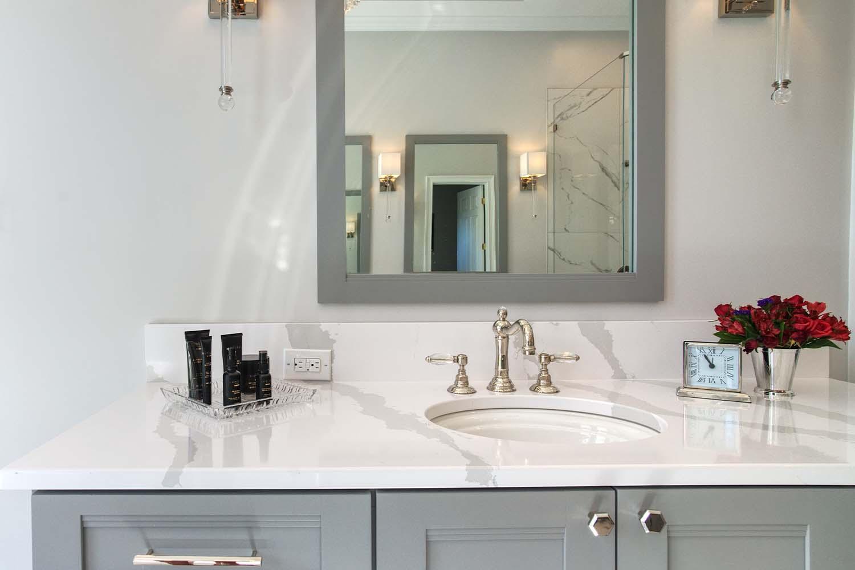 1luxury-lake-bathrooms-lake-norman-bathroom.sink_.marble.mirror.sconces