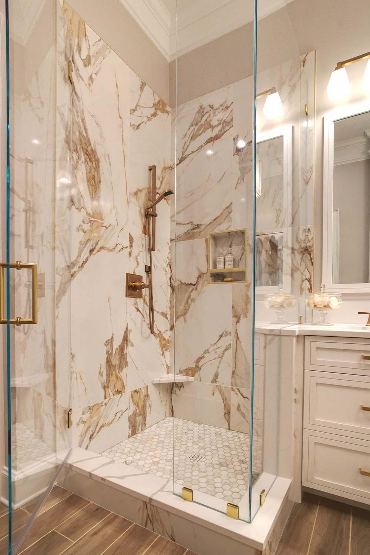 1luxury-lake-bathrooms-lake-norman-shower.gold_.fixtures.tile_